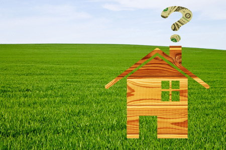 financial questions: House drawn on a background of grass blue sky and question mark made of the dollar notes Stock Photo