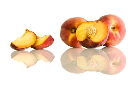 velvety: Whole peaches and slices and its reflection on a white isolated background Stock Photo