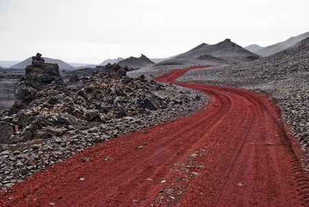 inhospitable: Red path in wasteland - Iceland Stock Photo