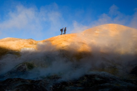 mud and snow: two tourists on the horizon in Kerlingarfjoll Stock Photo