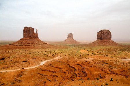 unpaved road: Big rocks in Monument Valley with unpaved road