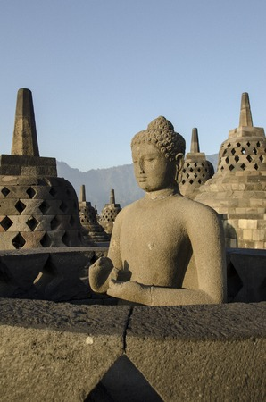 Statue Buddha, Borobudur, Java.breathtaking sunrise in Borobudur  Indonesia - Java.  photo