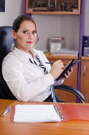 Beautiful young businesswoman in the office Stock Photo