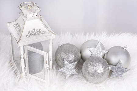Christmas decoration with lamp and balls in siver color Standard-Bild