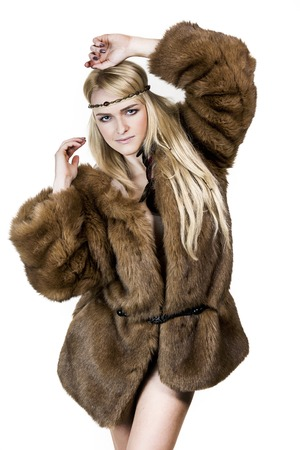 Blonde girl with long hair dressed in a fur coat