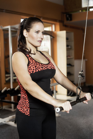 young woman is doing exercise in the fitness gym Standard-Bild