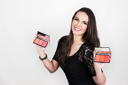 The beautiful girl holding two blush palette