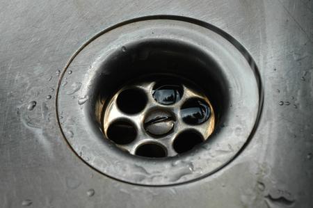 sink hole: Plug Hole in Kitchen Sink Stock Photo