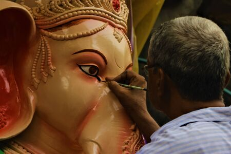 Ganesha is having makeup, ready to move to his uncle home