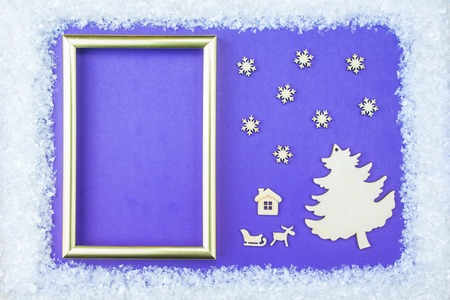 embellishments: Christmas frame consists of a white embellishments: snowflakes, reindeer, angel flight and gift boxes on a blue background. The apartment lay out the composition on websites, social media, magazines, bloggers, artists, etc. Stock Photo
