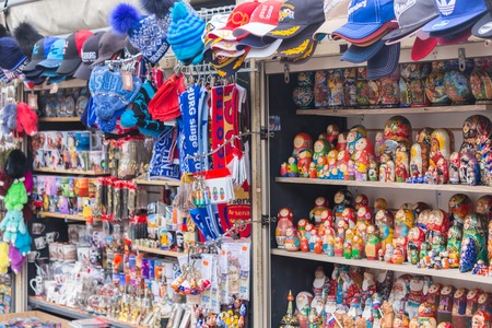 ST. PETERSBURG, RUSSIA - 2017 Traditional Russian matryoshkas nesting dolls on display in a souvenir shop in canal street trade in St. Petersburg, Russia. a set of Souvenirs on the streets of St. Petersburg Editorial