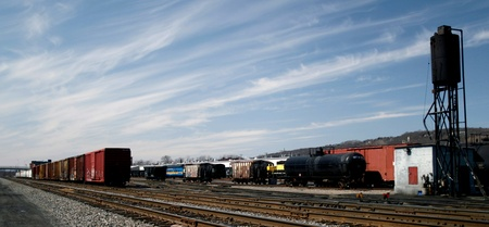 goods train: Freight cars sit in a railroad yard awaiting connection to a train engine.