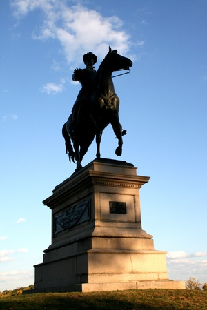 The statue of a Civil War hero on the ground of the site of the Battle of Gettysburg. Banco de Imagens