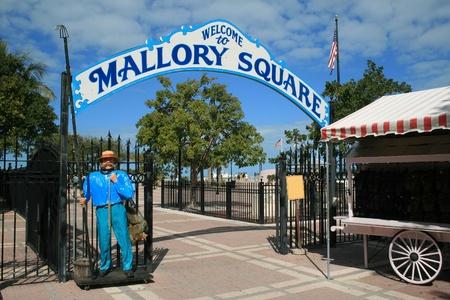 The entrance to the famed Mallory Square in Key West, Florida where residents and visitors gather each evening to watch spectacular sunsets.  photo
