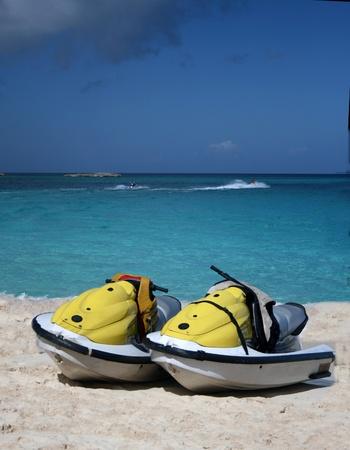 watercraft: Personal watercraft await riders on a Caribbean beach. Stock Photo