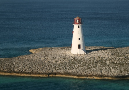 A lighthouse stands guard at the entrance to a Caribbean port. photo