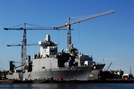 U.S. Navy ships being refitted and repaired at a Portsmouth, Virginia shipyard.