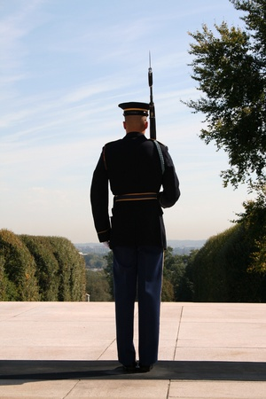 gravesite: An Honor Guard stands at attention at the Tomb of the Unknown Soldier, Arlington National Cemetery, Arlington, Virginia.