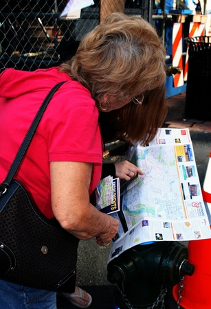 Tourists in Washington, DC pause to look over a map of attractions.
