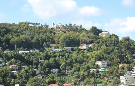 snugly: Homes nestled snugly on a hillside in the Caribbean port city of Bridgetown, Barbados