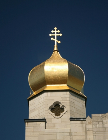 coptic orthodox: A gilded Eastern Orthodox Church dome is topped with a Coptic Christian cross  Stock Photo
