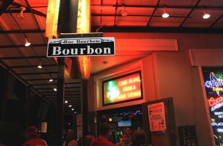 bourbon street: Colorful night shot of a street sign along Bourbon Street, New Orleans, Louisiana  Editorial
