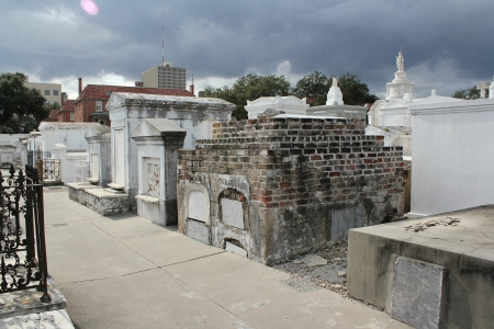 Is the object in the upper left corner of this photo of tombs in the historic St  Louis Cemetery  1 in New Orleans, Louisiana the image of a ghost   NOTE   This photo has NOT been altered in any way  photo