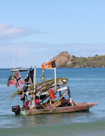 festooned: A colorful flag-festooned small boat carries a fruit vendor along Reduit Beach on the Caribbean island of St  Lucia  Editorial
