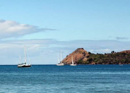 st lucia: Small boats at anchor at the tip of Reduit Beach on the Caribbean island of St Lucia