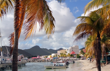 dwi: Small boats are moored along a beautiful beach on the Caribbean island of St  Martin  St  Maarten , DWI  Editorial
