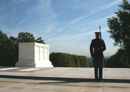 A member of the U S  Army honor guard pauses while walking his post at the Tomb of the Unknown Soldiers at Arlington National Cemetery, Arlington, Virginia