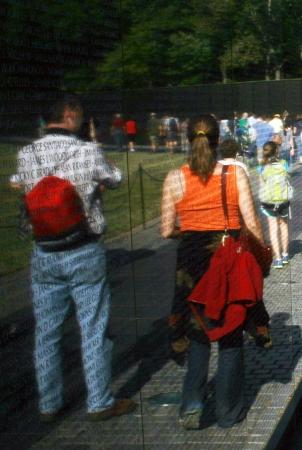 Visitors walking alongside the Vietnam Wall war memorial in Washington, DC