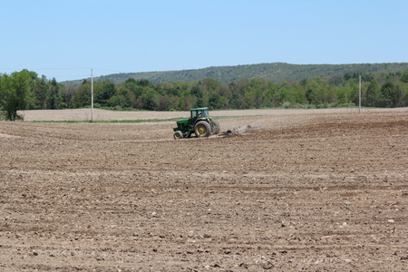 planting season: A farmer on his tractor plows a field in preparation for the spring planting season.