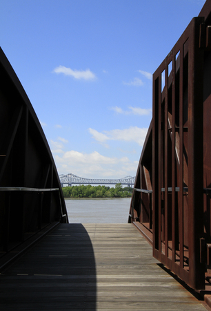 Open gate on elevated footpath near Mississippi river