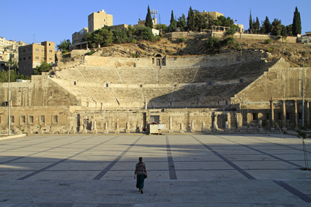 Woman walking towards Roman theater in Amman, Jordan