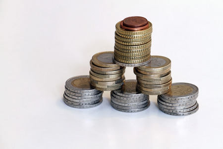 Small stack of coins in front of white background