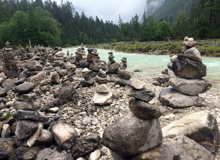 Stacking stones in the Alps - fleeting nature art