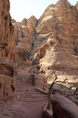 Stairs leading through a valley in the desert city of Petra, Jordan