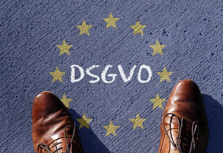EU flag with the acronym DSGVO (German version of GDPR - General Data Protection Regulation) written on it Stock Photo
