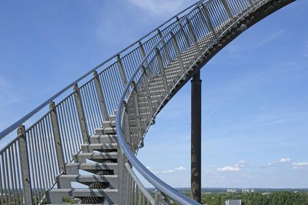 Career steps: a steep upward flight of stairs in front of a blue sky