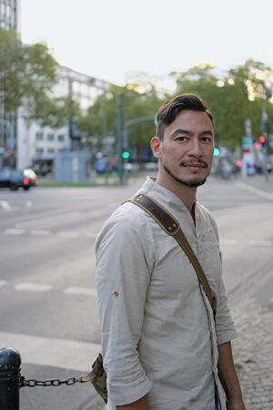 City life: Handsome man standing next to a road in the afternoon hours