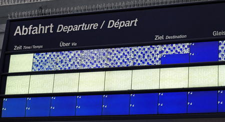 Frankfurt, Germany - July 13, 2019: Malfunctioning schedule display of the German train service at Frankfurt train station.