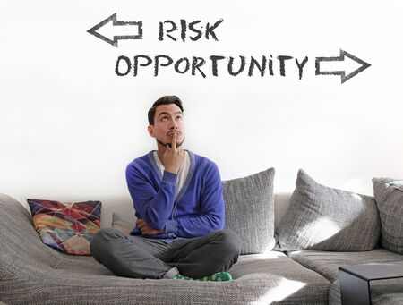 Man contemplating on couch, trying to decide between risk and opportunity Stock fotó