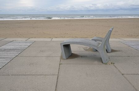 Two concrete benches at the coast of the Netherlands in Scheveningen near The Hague