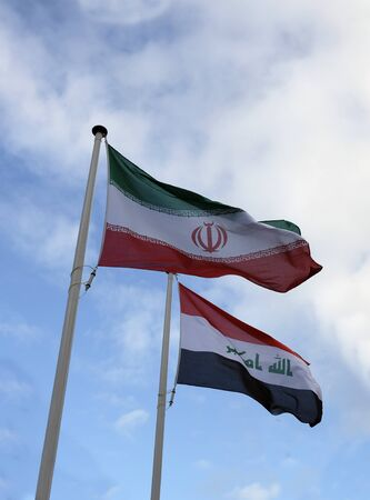 National flags of Iran and Iraq waving in the wind Stock fotó