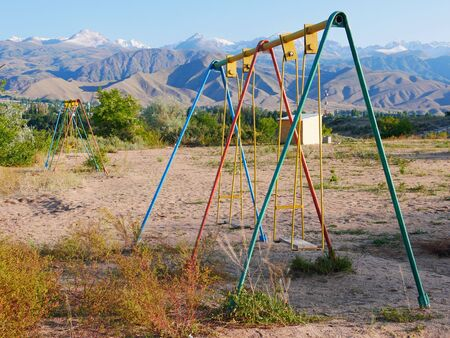 Swing on abandoned playground in Kyrgyzstan Stock fotó