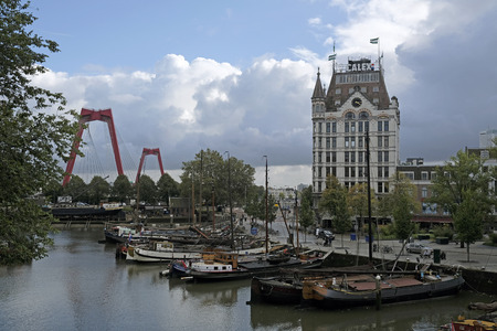 Rotterdam, Netherlands - October 4, 2019: Quiet scene in the city of Rotterdam with boats in the foreground and dramatic clouds in the background.