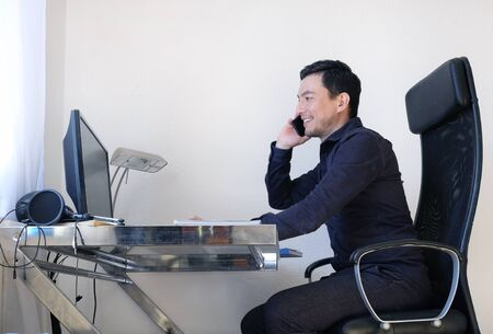 A man working from home at a desk Stock Photo