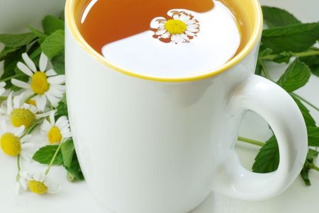 white cup with tea photo