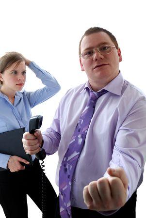 subordinated: aggressive boss Stock Photo